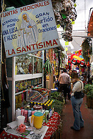 Woman shopping for medicinal plants and potions, in the market, city of Veracruz, Mexico