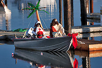 Comical boat with Christmas figures fishing. Bandon Harbor, OR