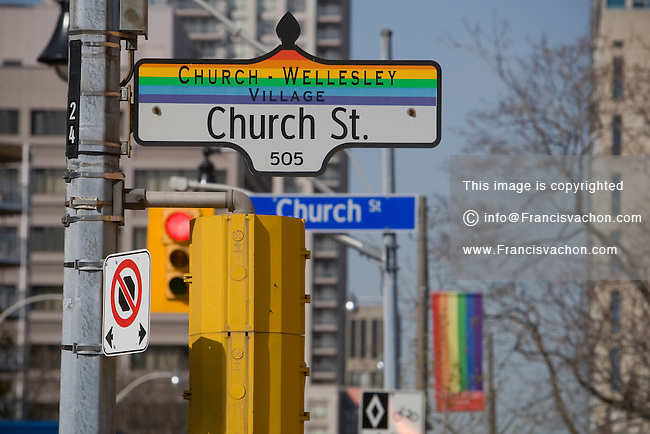 Church street sign decorated with the pride flag color is seen in Toronto Church and Wellesley village April 21, 2010. Church and Wellesley is an LGBT-oriented community located in Toronto, Ontario, Canada, roughly bounded by Gerrard Street to the south, Yonge Street to the west, Charles Street to the north, and Jarvis Street to the east, with the core commercial strip located along Church Street from Wellesley south to Alexander.