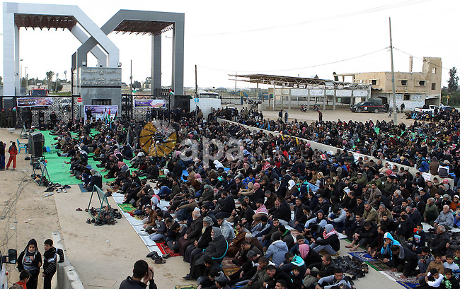 Palestinians perform Friday prayers at the Rafah border crossing between Egypt and southern Gaza Strip January 16, 2015, to demand that Egyptian authorities open the crossing. Egypt shut Rafah crossing, Gaza's main window to the outside world, over violence with Islamist militants in Egypt's adjacent Sinai region last October. Since then, it opened the crossing for a few days to allow thousands of Palestinians get in and out of Gaza Strip. Photo by Abed Rahim Khatib