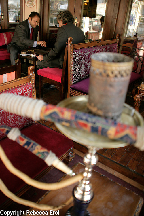 Playing backgammon with a hookah pipe in the foreground, Turkey