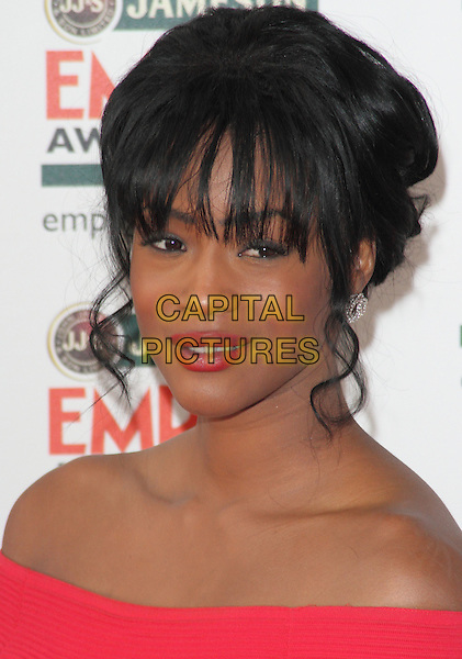 Tiana Benjamin.Jameson Empire Film Awards at the Grosvenor House Hotel, Park Lane, London, England..March 25th 2012.headshot portrait lipstick pink off the shoulder red  .CAP/ROS.©Steve Ross/Capital Pictures