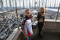 "New York, USA. 23 April 2014.  Supercross motorcycle racer Mike Alessi and ""Miss Supercross"" Dianna Dahlgren hold the trophy as they promote their motorcycle race during a visit to the Empire State Building in New York. Photo by Eduardo Munoz Alvarez/VIEWpress"