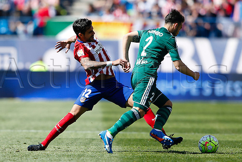 02.04.2016. Madrid, Spain.  Augusto Fernandez (12) Atletico de Madrid challenges Francisco Molinero (2) Real Betis. La Liga match between Atletico de Madrid and Real Betis at the Vicente Calderon stadium in Madrid, Spain, April 2, 2016 .