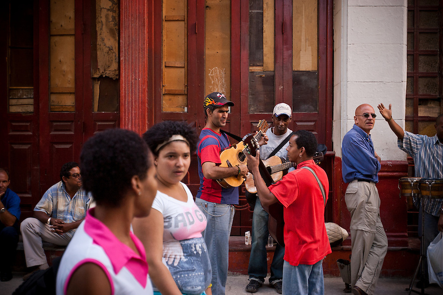 Cubans linger on Calle San Nicolas after a tai chi street performance, in Barrio Chino, Havana, Cuba, on Saturday, April 19, 2008. In the past couple of years, the Cuban government has been revitalizing Chinatown to attract tourists and to preserve the Chinese contributions to Cuban culture.