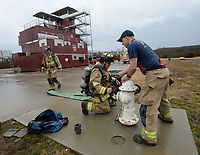 NWA Democrat-Gazette/ANDY SHUPE<br /> Marcus Mason (right) and Nathan Whitekiller, both of the Fayetteville Fire Department, charge a firehose Wednesday, March 13, 2019, while working on high rise firefighting training at the department's training facility in south Fayetteville. City voters will head to the polls April 9 to consider 10 bond questions totaling more than $226 million in projects. About $15 million is included for the Fire Department for three new fire stations, trucks and equipment.