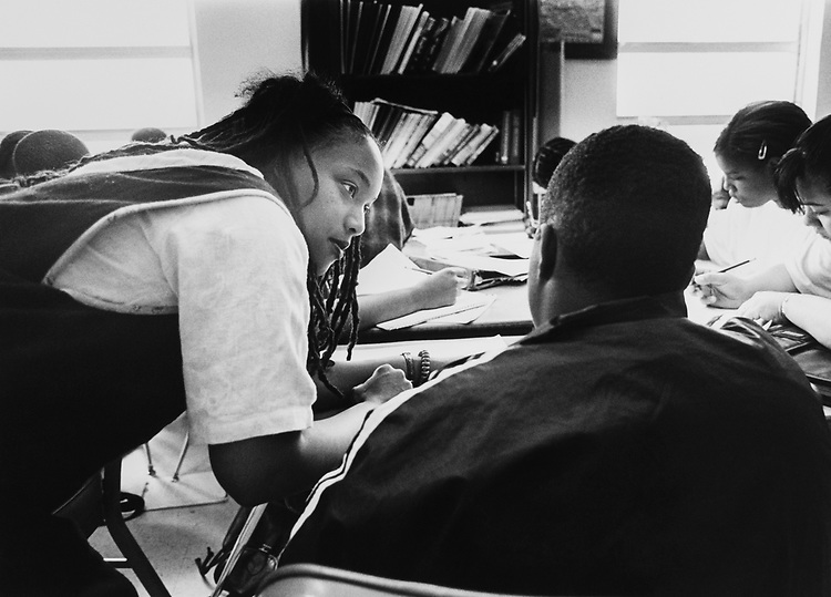 English Teacher Alemtsehiye Tzion with students at Options Public Charter School in May 1997. (Photo by Maureen Keating/CQ Roll Call via Getty Images)