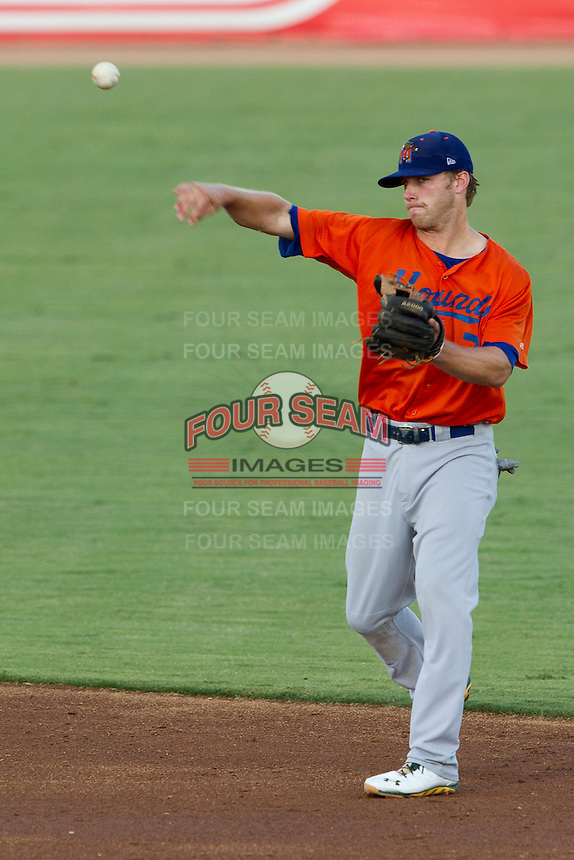 Midland Rockhounds second baseman Dusty Coleman (7) makes a throw to first base during the Texas League baseball game against the San Antonio Missions on July 13, 2013 at Nelson Wolff Municipal Stadium in San Antonio, Texas. The Missions defeated the Rock Hounds 5-4. (Andrew Woolley/Four Seam Images)