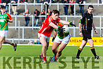 East Kerry David Spillane gets to the ball ahead of Mike breen Mid Kerry during the County Minor Championship final in Fitzgerald Stadium on Sunday