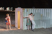 "Dinslaken, Germany. 12 August 2015. Elsie de Brauw as Amore/Nannina, Sandra Hüller as Magdalena and Steven Scharf as Accattone. Performance of the Pier Paolo Pasolini play ""Accattone"" at Ruhrtriennale festival of the arts at Kohlenmischhalle of Schacht Lohberg in Dinslaken, North Rhine-Westphalia, Germany. Accattone is directed by festival director Johan Simons with music by Johann Sebastian Bach conducted by Philippe Herreweghe. With Steven Scharf as Accattone."