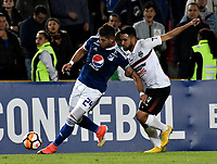 BOGOTÁ - COLOMBIA, 15-08-2018: Matías de los Santos (Izq.) jugador de Millonarios (COL), disputa el balón con Wilson Ibarrola (Der.) jugador de General Díaz (PAR), durante partido de vuelta entre Millonarios (COL) y General Díaz (PAR), de la segunda fase por la Copa Conmebol Sudamericana 2018, en el estadio Nemesio Camacho El Campin, de la ciudad de Bogotá. / Matias de los Santos (L) player of Millonarios (COL), fights for the ball with Wilson Ibarrola (R) player of General Diaz (PAR), during a match of the second leg between Millonarios (COL) and General Diaz (PAR), of the second phase for the Conmebol Sudamericana Cup 2018 in the Nemesio Camacho El Campin stadium in Bogota city. VizzorImage / Luis Ramirez / Staff.