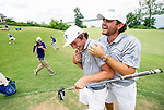 MUSCLE SHOALS, AL - MAY 25: Lynn's Carlos Bustos is greeted by team mate Tomas Dana after sinking the winning putt during the Division II Men's Team Match Play Golf Championship held at the Robert Trent Jones Golf Trail at the Shoals, Fighting Joe Course on May 25, 2018 in Muscle Shoals, Alabama. Lynn defeated West Florida 3-2 to win the national title. (Photo by Cliff Williams/NCAA Photos via Getty Images)