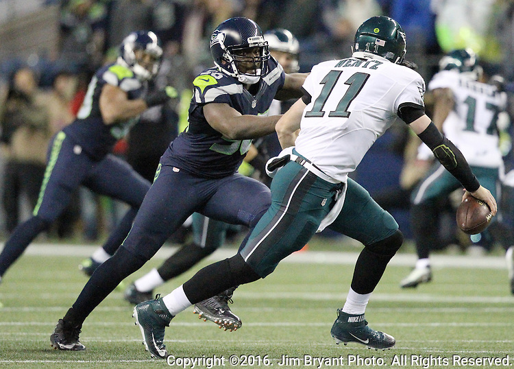 Seattle Seahawks defensive end Cliff Avril (56) pressures Philadelphia Eagles quarterback Carson Wentz (11)<br /> at CenturyLink Field in Seattle, Washington on November 20, 2016.  Seahawks beat the Eagles 26-15.  &copy;2016. Jim Bryant Photo. All Rights Reserved.