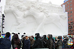 February 4, 2019, Sapporo, Japan - Visitors admire a large snow sculpture of horse racing displayed at the 70th annual Sapporo Snow Festival in Sapporo in Japan's nortern island of Hokkaido on Monday, February 4, 2019. The week-long snow festival started at the Odori Park in central Sapporo through February 11 and over 2.5 million people are expecting to visit the festival.   (Photo by Yoshio Tsunoda/AFLO)