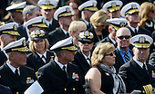 Navy Officers attend a memorial for the victims of the Washington Navy Yard shooting at the Marine Barracks, September 22, 2013 in Washington, D.C. United States President Barack Obama and first lady Michelle Obama also visited with families of the victims. <br /> Credit: Olivier Douliery / Pool via CNP