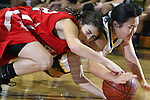 Palos Verdes, CA January 19, 2010 - Victoria Yutronich (32) and Lindsey Sugimoto (25) fight over a loose ball in the first period during the Palos Verdes vs Peninsula Panthers basketball game at Peninsula High School.