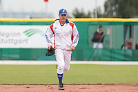 27 july 2010: Gregory Cros of France runs to the mound during France 8-2 victory over Belgium, in day 5 of the 2010 European Championship Seniors, in Stuttgart, Germany.