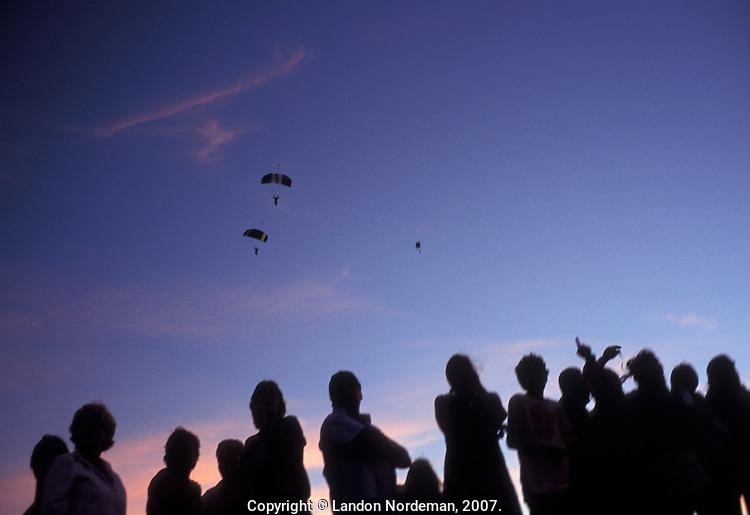 PUNTA DEL ESTE, URUGUAY- MARCH 2005:  People watch sky divers and paragliders in Punta del Este, Uruguay.  (photo by Landon Nordeman)