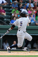 Third baseman Miguel Andujar (5) of the Charleston RiverDogs in a game against the Greenville Drive on Wednesday, June 11, 2014, at Fluor Field at the West End in Greenville, South Carolina. Andujar is the No. 18 prospect of the New York Yankees, according to Baseball America. Greenville won, 6-3. (Tom Priddy/Four Seam Images)