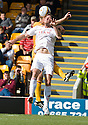 ABERDEEN'S SCOTT VERNON AND MOTHERWELL'S STEPHEN CRAIGAN  CHALLENGE FOR THE HIGH BALL
