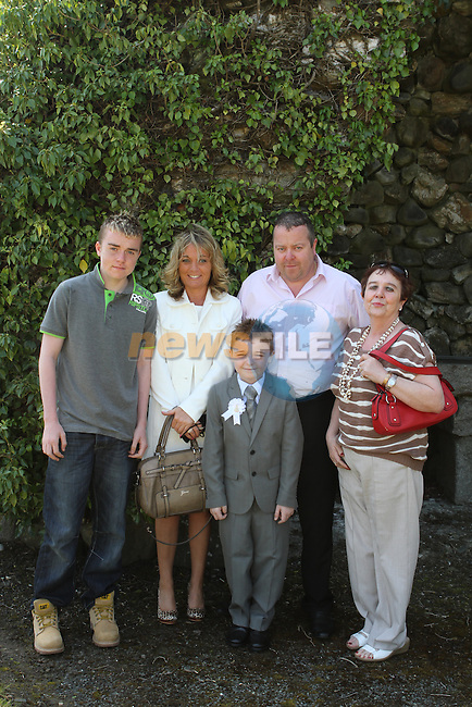 Ben Butterly with his family at Tullydonnell NS Communion...(Photo Jenny Matthews/www.newsfile.ie)