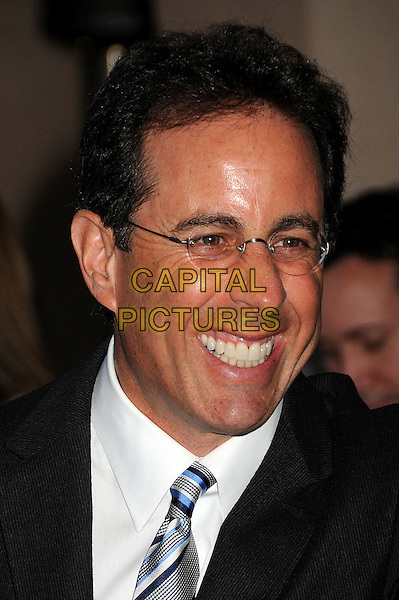 JERRY SEINFELD .NBC Universal Press Tour Cocktail Party held at the Langham Hotel, Pasadena, California, USA, 10th January 2010..portrait headshot black glasses blue striped tie white shirt smiling teeth .CAP/ADM/BP.©Byron Purvis/AdMedia/Capital Pictures.