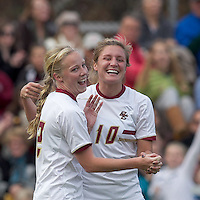 Boston College midfielder Julia Bouchelle (12) celebrates her goal with teammates.  Boston College defeated Marist College, 6-1, in NCAA tournament play at Newton Campus Field, November 13, 2011.