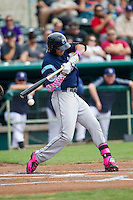 Corpus Christi Hooks shortstop Carlos Correa (1) checks his swing as the ball hits hit bat during the Texas League baseball game against the San Antonio Missions on May 10, 2015 at Nelson Wolff Stadium in San Antonio, Texas. The Missions defeated the Hooks 6-5. (Andrew Woolley/Four Seam Images)