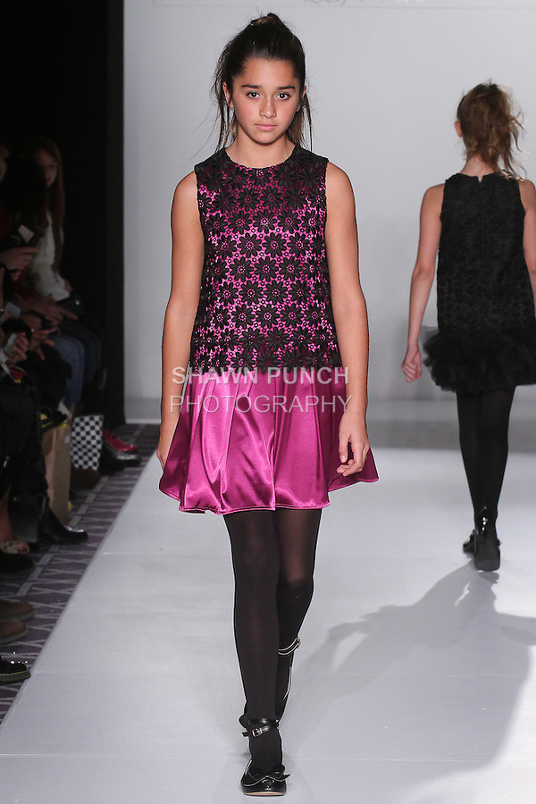"Model walks runway in an outfit from the Michelle Ann Fall Winter 2016 ""Equestrian Chic"" collection, at Fashion Gallery New York Fashion Week, during New York Fashion Week Fall 2016."