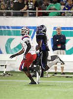 First Coast Buccaneers wide receiver Christopher Black #1 goes down field on a pass route covered by Brent Yancy #31 (white jersey) during the fourth quarter of the Florida High School Athletic Association 7A Championship Game at Florida's Citrus Bowl on December 16, 2011 in Orlando, Florida.  Manatee defeated First Coast 40-0.  (Mike Janes/Four Seam Images)
