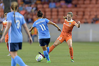 Houston, TX - Friday April 29, 2016: Cami Privett (23) of the Houston Dash attempts to dribble the ball around Raquel Rodriguez (11) of Sky Blue FC at BBVA Compass Stadium. The Houston Dash tied Sky Blue FC 0-0.
