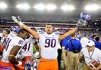 Jan. 4, 2010; Glendale, AZ, USA; Boise State Broncos defensive tackle (90) Billy Winn celebrates following the game against the TCU Horned Frogs in the 2010 Fiesta Bowl at University of Phoenix Stadium. Boise State defeated TCU 17-10. Mandatory Credit: Mark J. Rebilas-