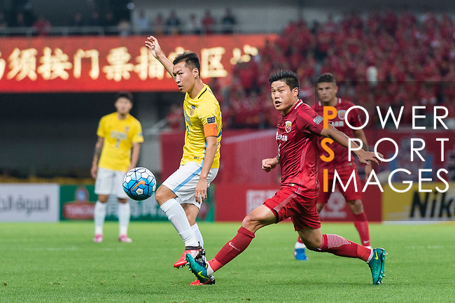 Jiangsu FC Midfielder Wu Xi (L) fights for the ball with Shanghai FC Midfielder Cai Huikang (R) during the AFC Champions League 2017 Round of 16 match between Shanghai SIPG FC (CHN) vs Jiangsu FC (CHN) at the Shanghai Stadium on 24 May 2017 in Shanghai, China. Photo by Marcio Rodrigo Machado / Power Sport Images