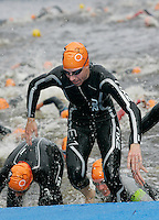 01 SEP 2007 - HAMBURG, GER - Competitors leave the water at the end of the first lap - Elite Womens World Triathlon Championships. (PHOTO (C) NIGEL FARROW)