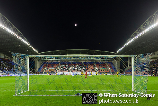Wigan Athletic 1 Shrewsbury Town 0, 21/11/2015. DW Stadium, League One. The DW Stadium. Wigan Athletic earned a narrow 1-0 at home to Shrewsbury Town. Wigan competed in the Premier League from 2005 to 2013. They won the 2013 FA Cup. The club also embarked on its first European campaign during the 2013–14 UEFA Europa League. Wigan Athletic's Jussi Jääskeläinen launches a clearance downfield in injury time, as The Moon rises above the DW Stadium.  Photo by Paul Thompson