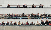 People watch from roof tops as United States President Donald Trump and First Lady Melania Trump walk in their inaugural parade after being sworn-in as the 45th President in Washington, D.C. on January 20, 2017.   <br /> Credit: Kevin Dietsch / Pool via CNP