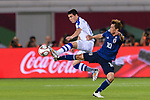 Azizbek Turgunboev of Uzbekistan (L) fights for the ball with Takashi Inui of Japan (R) during the AFC Asian Cup UAE 2019 Group F match between Japan (JPN) and Uzbekistan (UZB) at Khalifa Bin Zayed Stadium on 17 January 2019 in Al Ain, United Arab Emirates. Photo by Marcio Rodrigo Machado / Power Sport Images