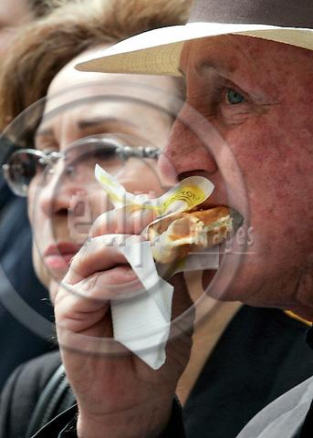 BRUSSELS - BELGIUM - 23 MAY 2005-- Brussels city centre. -- An elderly gentleman eating a waffle. -- PHOTO: JUHA ROININEN / EUP-IMAGES