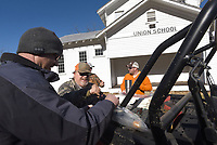 NWA Democrat-Gazette/FLIP PUTTHOFF <br /> Kris Muldoon (from left) and Mike Howard slice some venison sausage for lunch Dec. 21 2018 during an off-road tour of rural Johnson County and the Ozark National Forest.