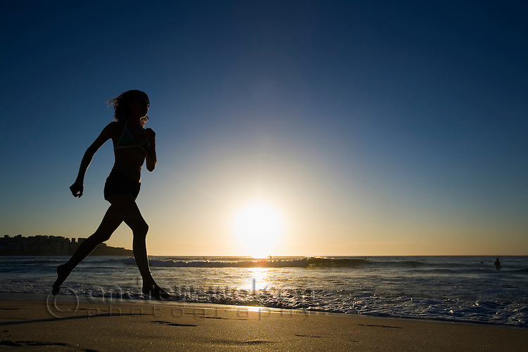 Morning jogger on the beach at Bondi.  Bondi Beach, Sydney, New South Wales, AUSTRALIA.