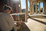 Jake Brown paints a campus scene for the Intermediate Painting class.  Photo by Kevin Bain/University Communications Photography