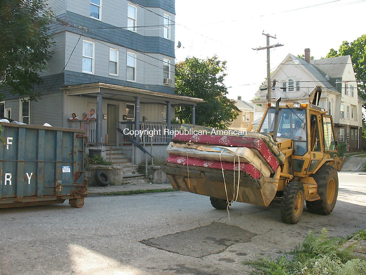WATERBURY, CT - 25 September 2009 - 092409RA03 - More than two dozen old, dirty mattresses were removed Thursday from three junk-filled homes on Vermont Street. The cleanup was coordinated by the Waterbury Police Department's Community Relations and Blight Enforcement Division with assistance from the Refuse and Street departments and Community Court clients.