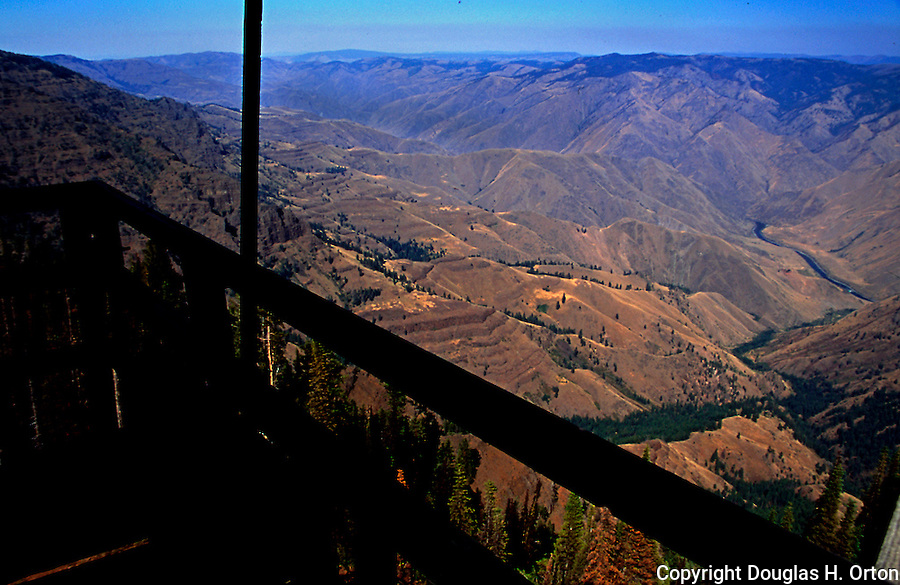 Ironically, this fire lookout view is impaired by forest fire smoke! Hat Point juts into Hells Canyon 5000 feet over the Snake River between the Imnaha and Saddle Creek Canyons.