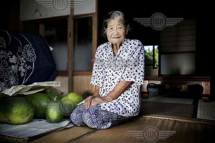 98 year old Aoki Miyoko kneels on a mat in her home, next to a pile of watermelons that she grows in her garden. According to United Nations statistics, Japan has the World's highest overall life expectancy and the highest for women.
