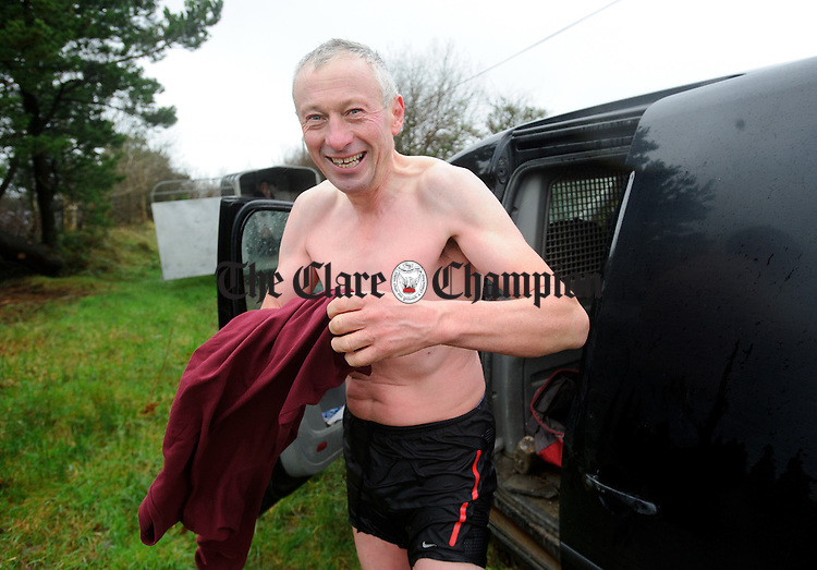 John O Connell dries off following the annual Christmas day swim at Gortglas  Lake, Kildysart in aid of the West Clare Mini Marathon Cancer fund. Photograph by John Kelly.