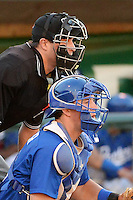 Austin Cowen (15) of the Ogden Raptors on defense against the Great Falls Voyagers as home plate umpire Patrick Sharshel calls the action at Lindquist Field on August 13, 2013 in Ogden Utah. (Stephen Smith/Four Seam Images)