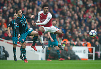 Southampton's Dusan Tadic and Arsenal's Alex Iwobi during the EPL - Premier League match between Arsenal and Southampton at the Emirates Stadium, London, England on 8 April 2018. Photo by Andrew Aleksiejczuk / PRiME Media Images.