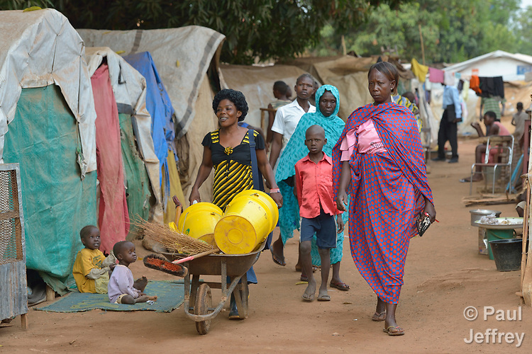 People walk through a camp for more than 12,000 internally displaced persons located on the grounds of the Roman Catholic Cathedral of St. Mary in Wau, South Sudan. Most of the families here were displaced in June, 2016, when armed conflict engulfed Wau.<br /> <br /> Norwegian Church Aid, a member of the ACT Alliance, has provided relief supplies to the displaced in Wau, and has supported the South Sudan Council of Churches as it has struggled to mediate the conflict in Wau.