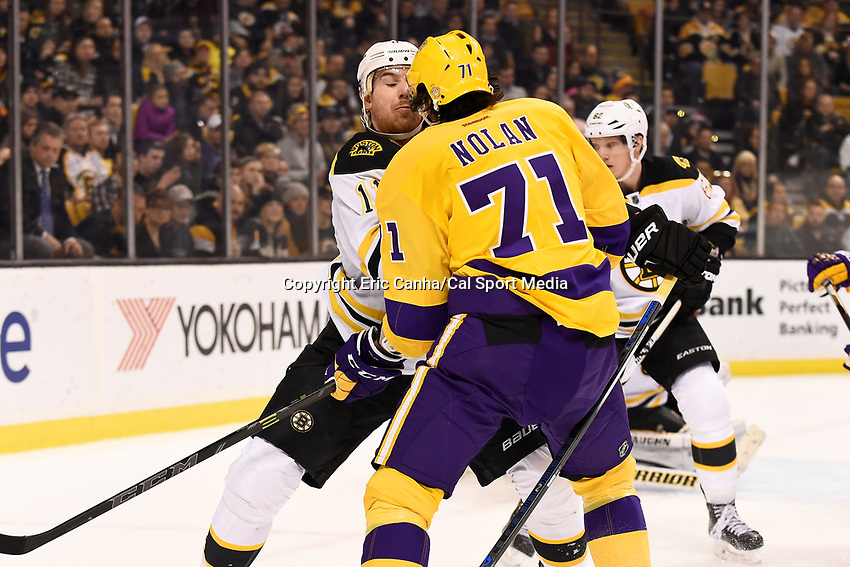 Tuesday, February 9, 2016: Boston Bruins right wing Jimmy Hayes (11) checks Los Angeles Kings center Jordan Nolan (71) during the National Hockey League game between the Los Angeles Kings and the Boston Bruins, held at TD Garden, in Boston, Massachusetts. The Kings defeat the Bruins 9-2. Eric Canha/CSM