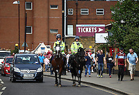 Mounted Police patrol seen near the Boleyn ground  before  the Barclays Premier League match between West Ham United and Swansea City  played at Boleyn Ground , London on 7th May 2016